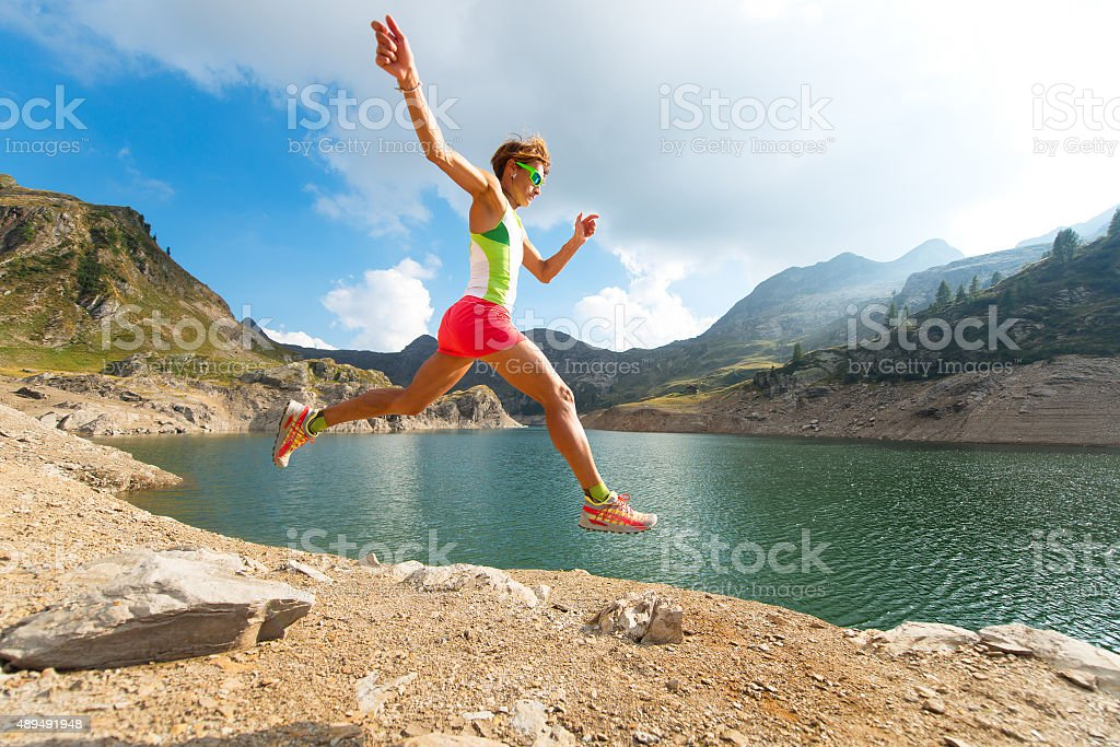 Jump while running trail stock photo