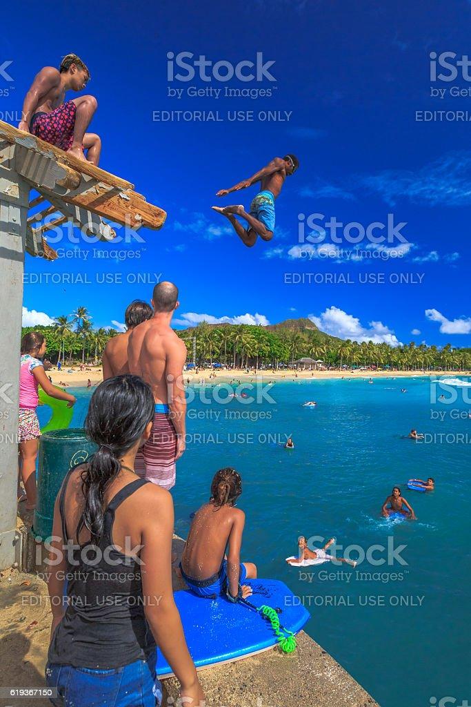 Jumper in Waikiki Pier stock photo