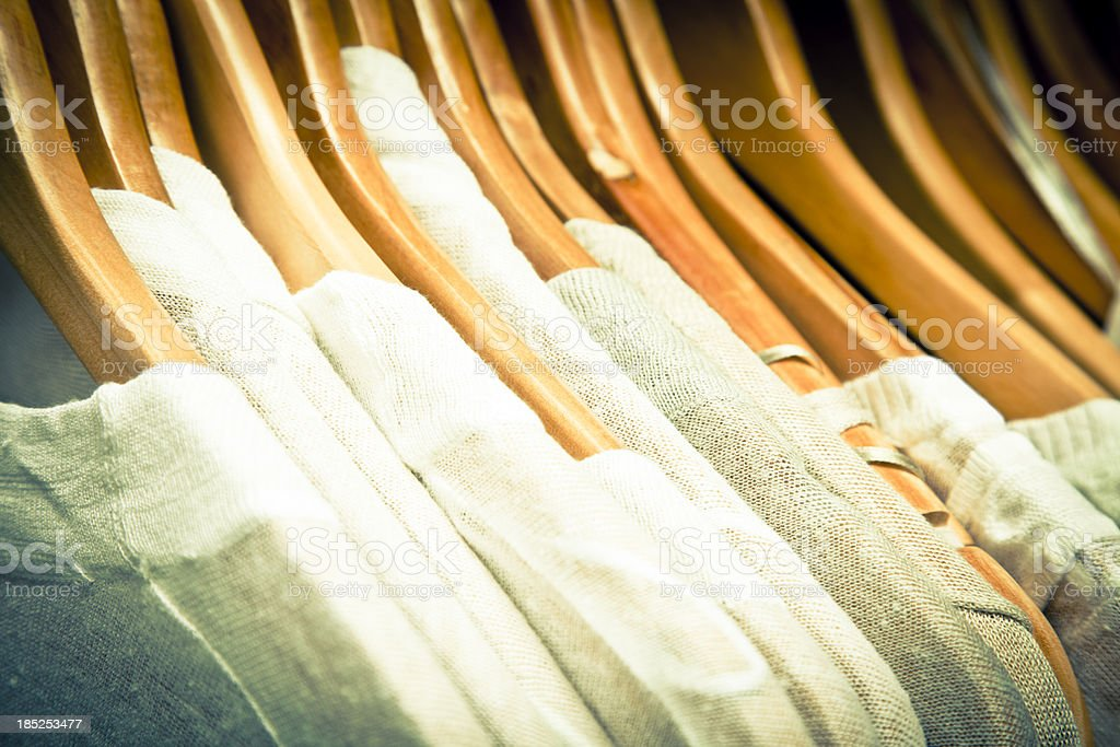 Jumpers in hangers royalty-free stock photo