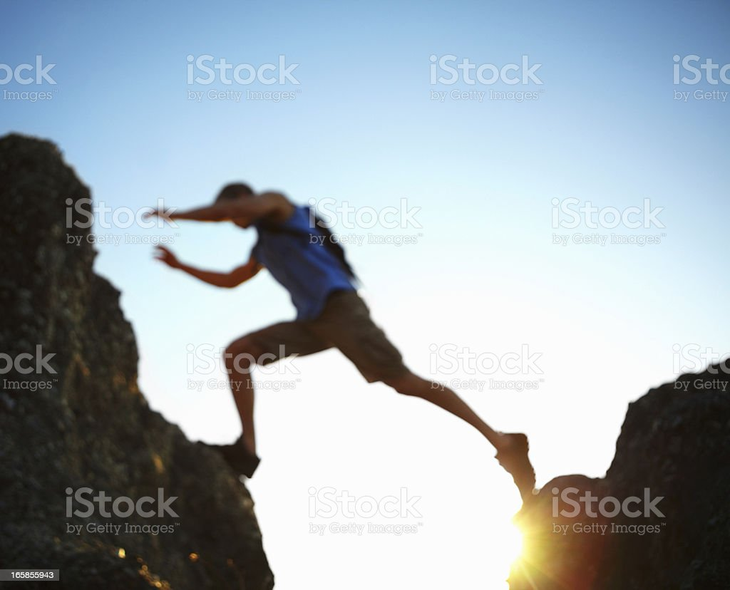 Jumping a gap stock photo