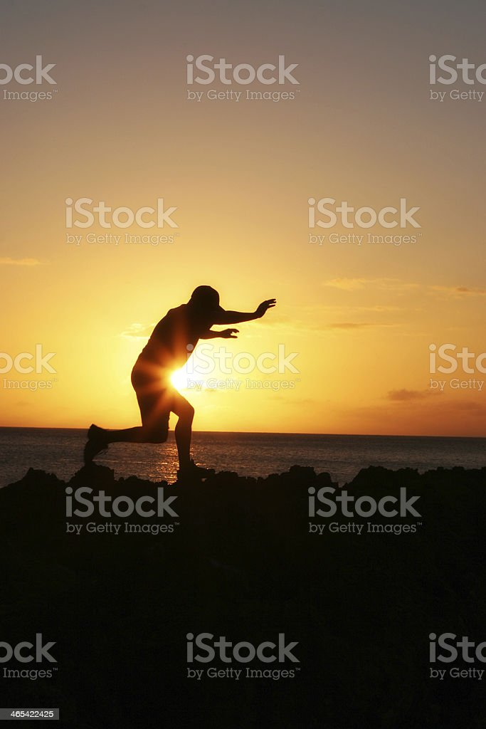 Jumping Across Sunset royalty-free stock photo