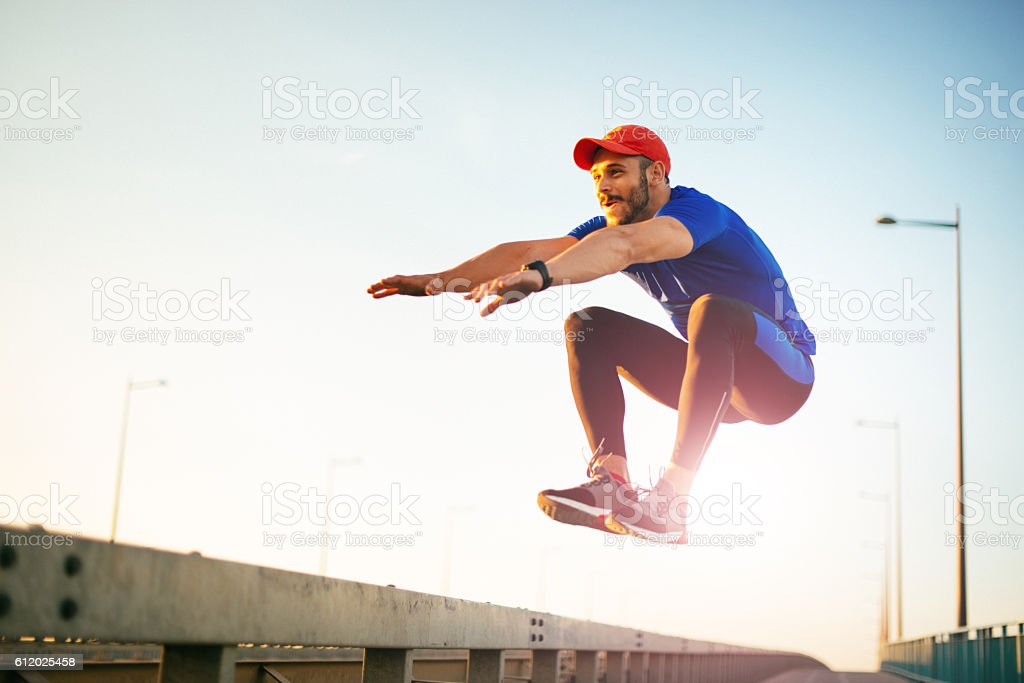 Jumping and practicing parkour stock photo