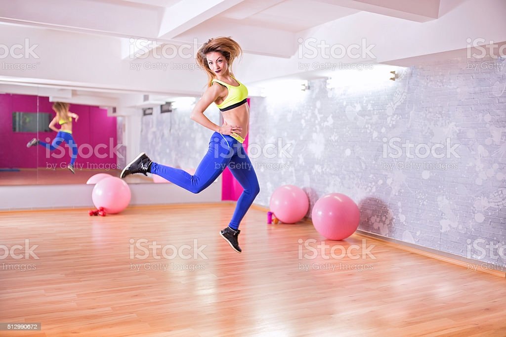 Jumping at the gym stock photo
