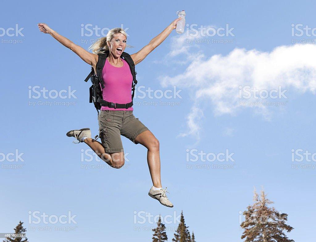 Jumping: Beautiful Female Hiker stock photo