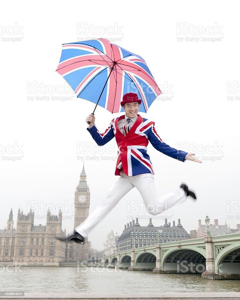 Jumping British Man in London with Big Ben stock photo