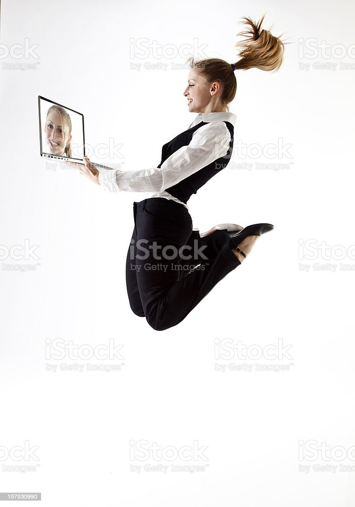 jumping business woman with laptop royalty-free stock photo
