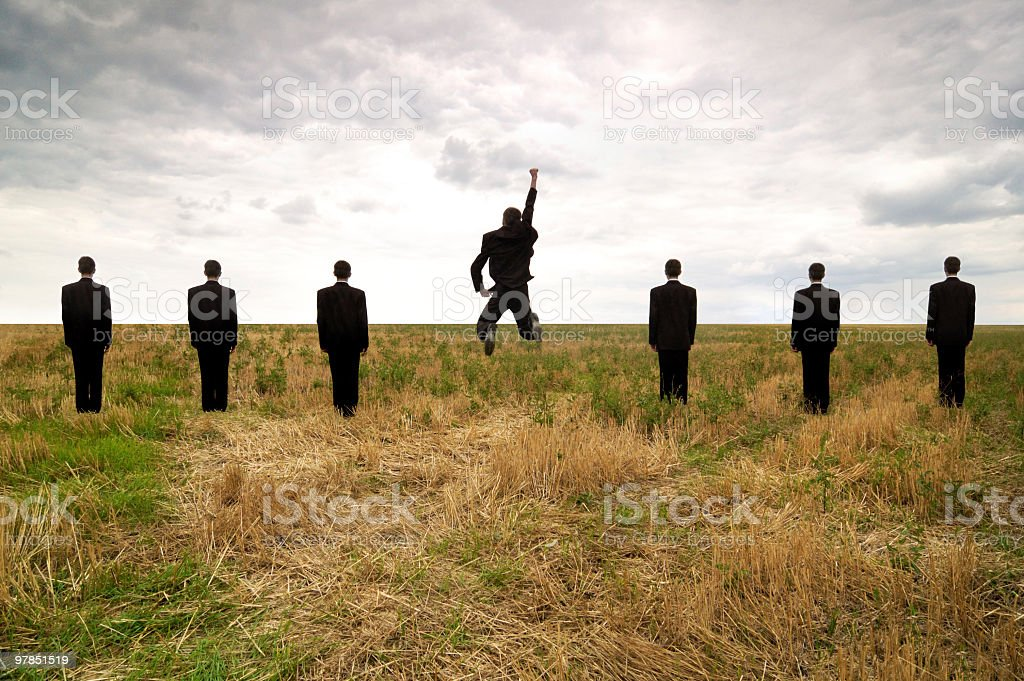 jumping businessman in a line of seven royalty-free stock photo
