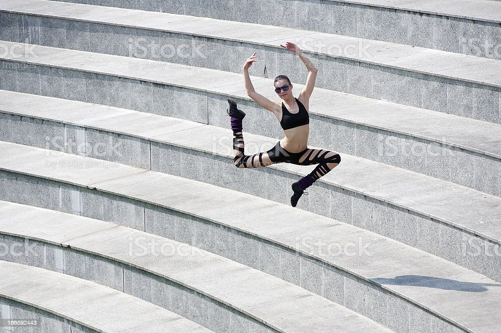 jumping dancer in arena royalty-free stock photo