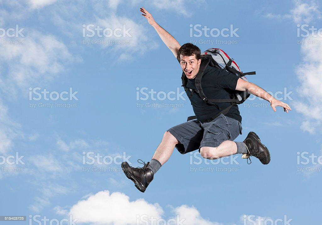 Jumping: Excited Backpacker stock photo