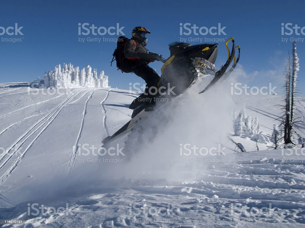 jumping extreme snowmobile royalty-free stock photo