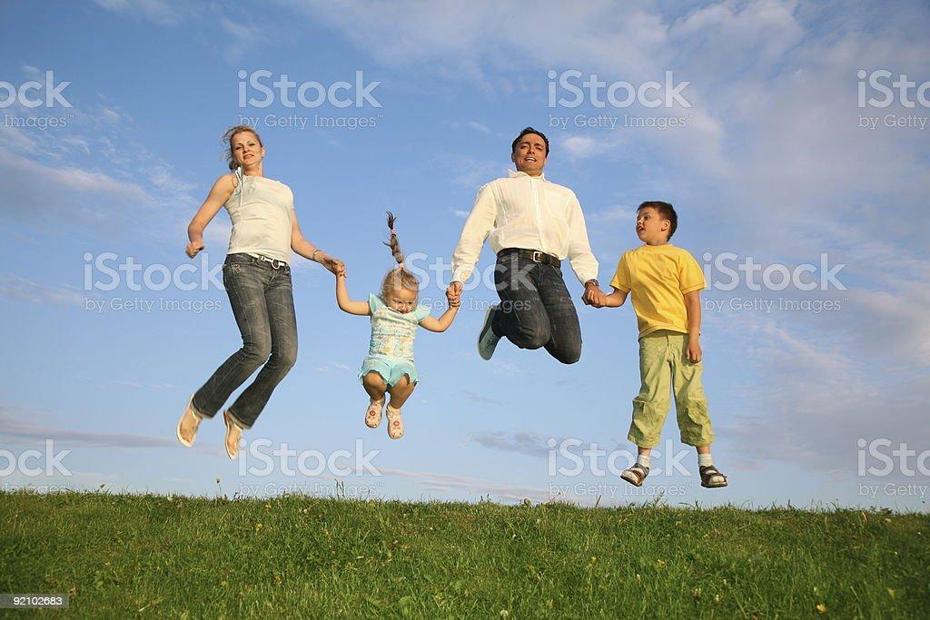 jumping family grass sky royalty-free stock photo