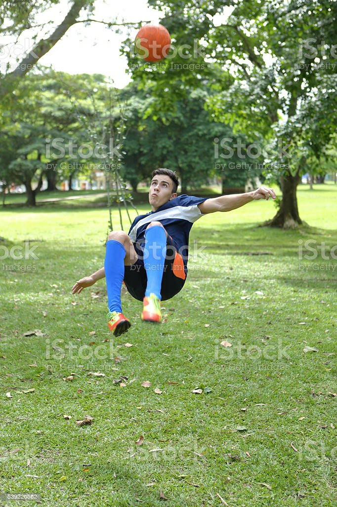 Jumping for Overhead Kick Front View stock photo