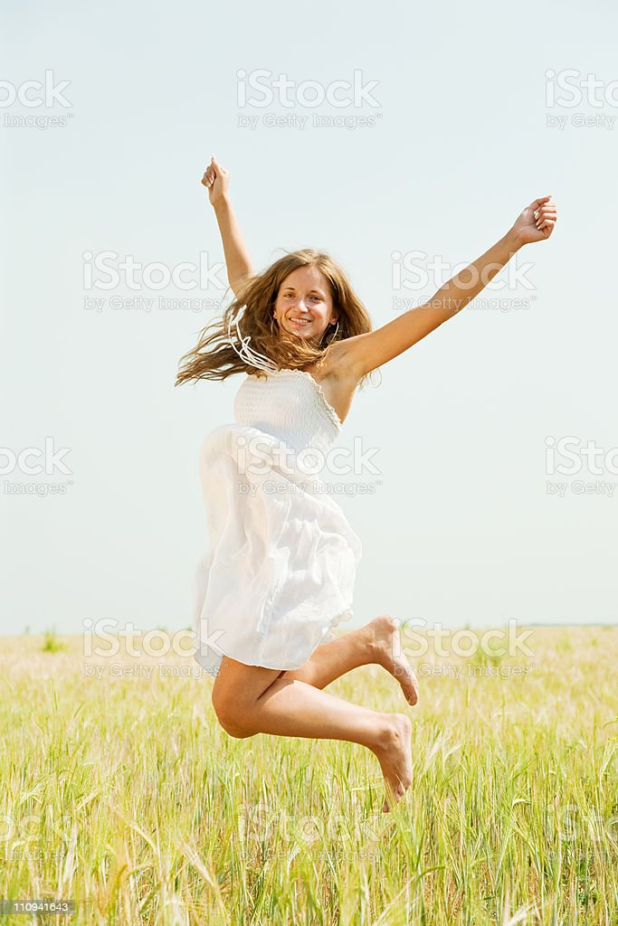 Jumping girl  at cereals field royalty-free stock photo