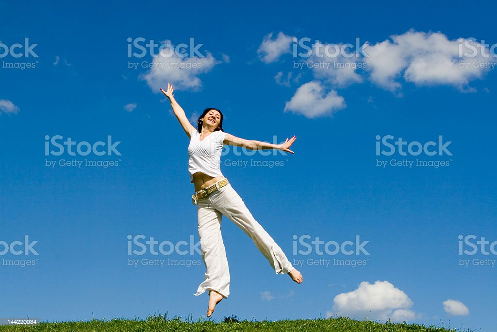 jumping girl in meadow royalty-free stock photo