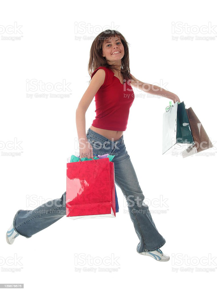 Jumping girl with shopping bags royalty-free stock photo