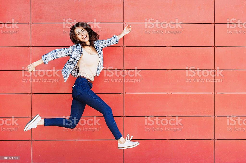 Jumping happy girl stock photo