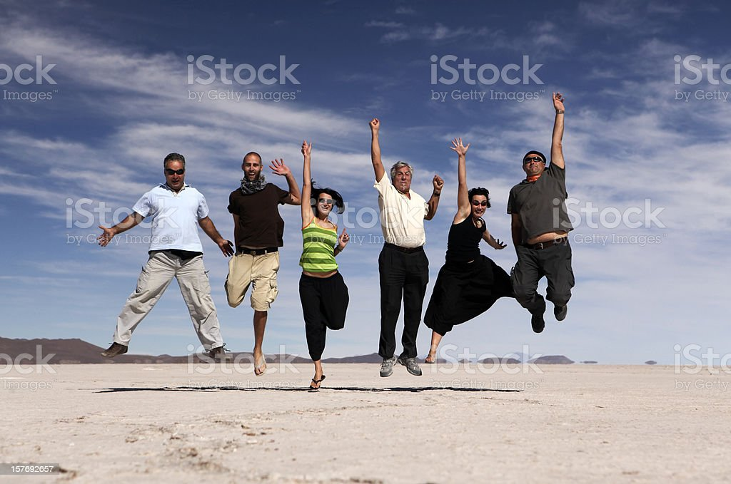 Jumping happy people royalty-free stock photo