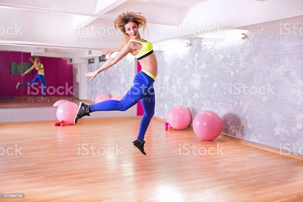 Jumping happy woman stock photo