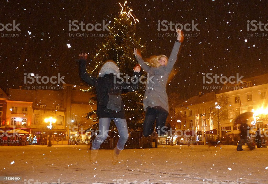 Jumping in a city winter scene stock photo