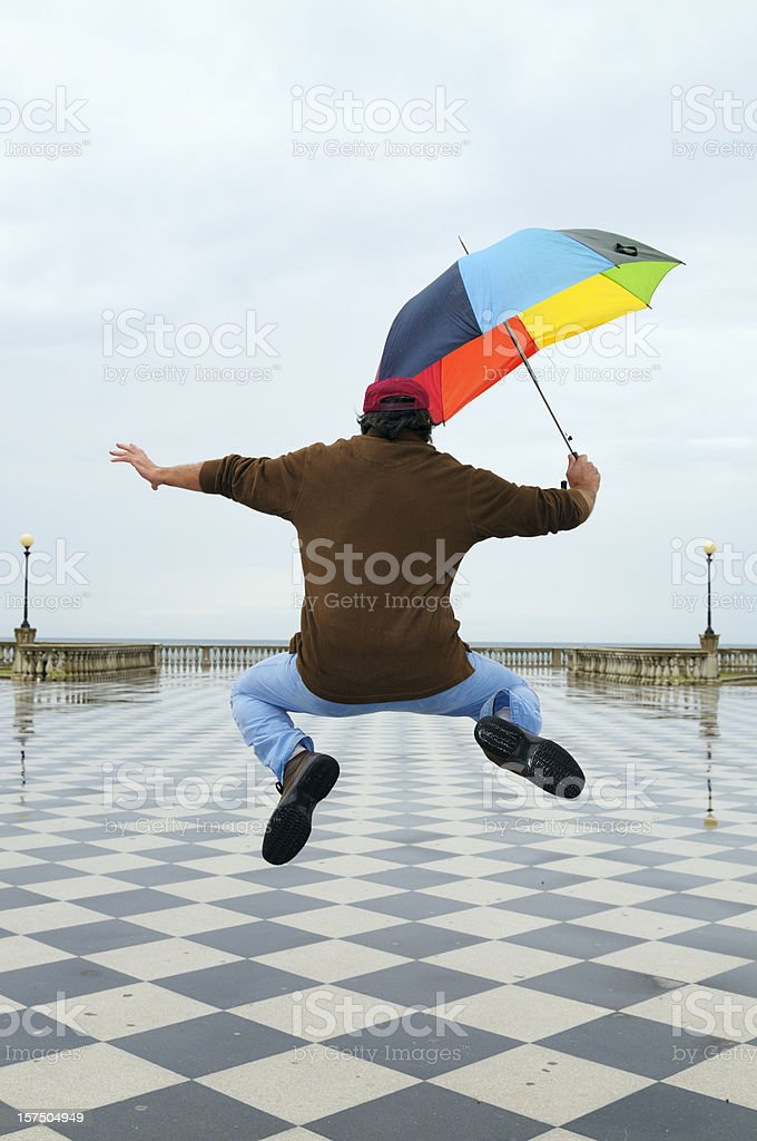 jumping in a rainy day royalty-free stock photo