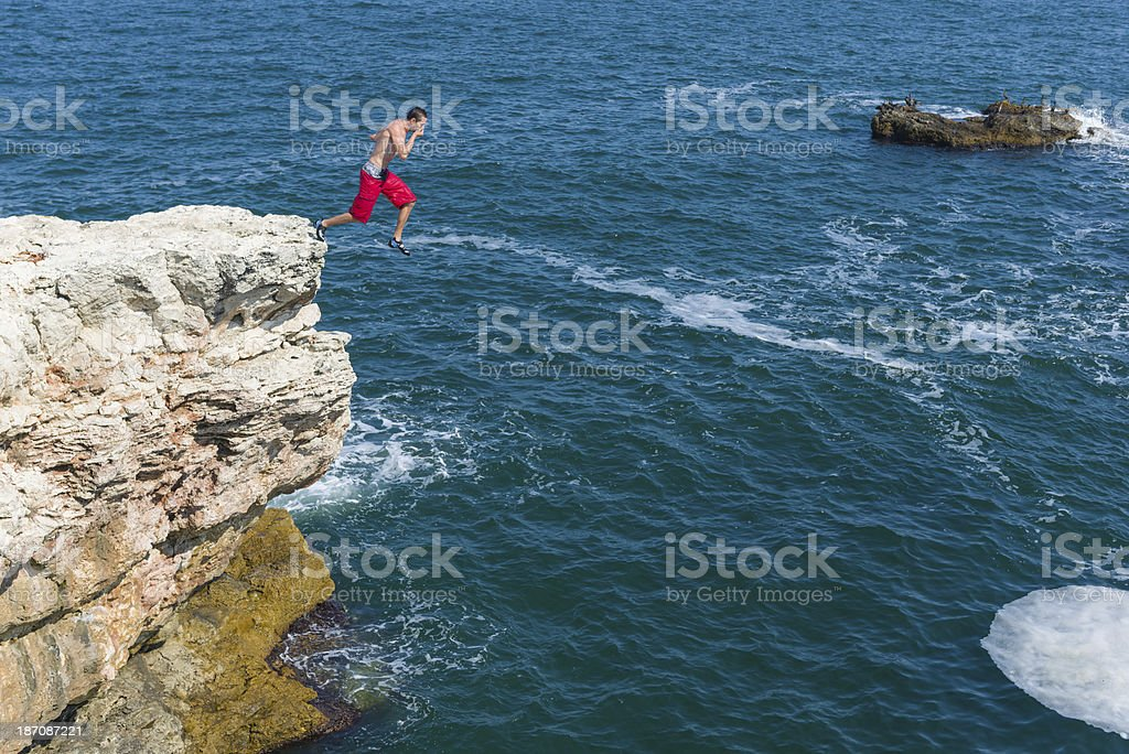 Jumping in the sea stock photo