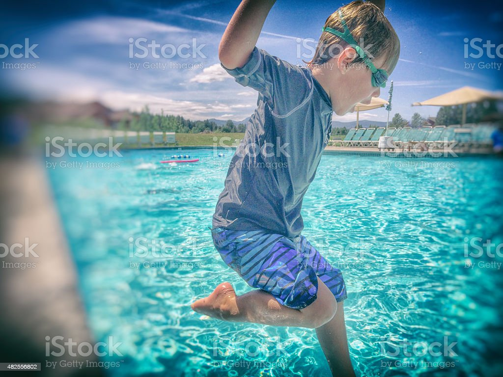 Jumping into a pool stock photo