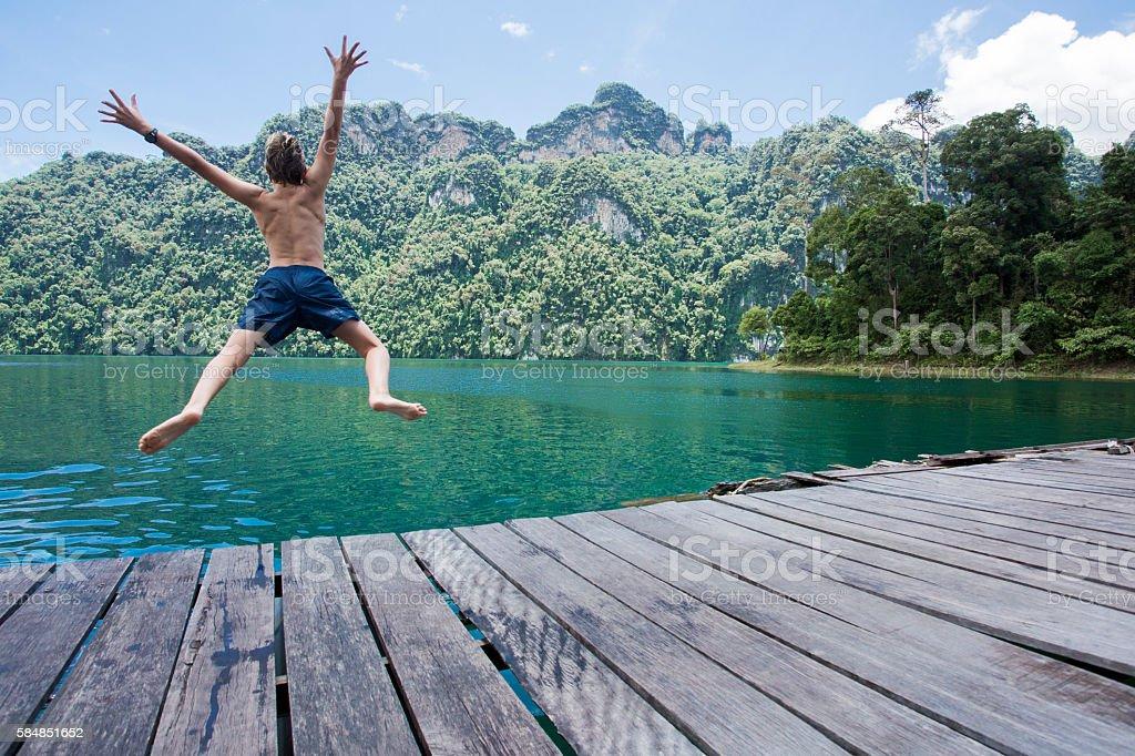 Jumping into Kao Sok National Park lake stock photo