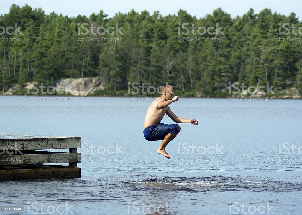 Jumping into Lake royalty-free stock photo