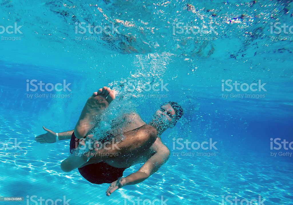 Jumping into pool stock photo