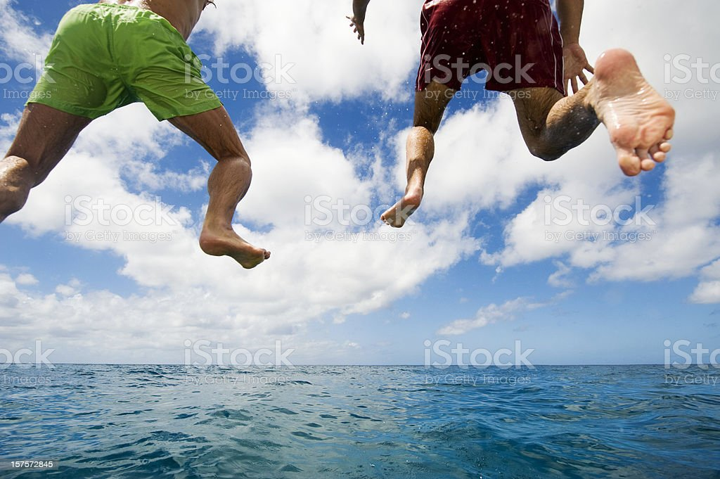 Jumping into Sea stock photo