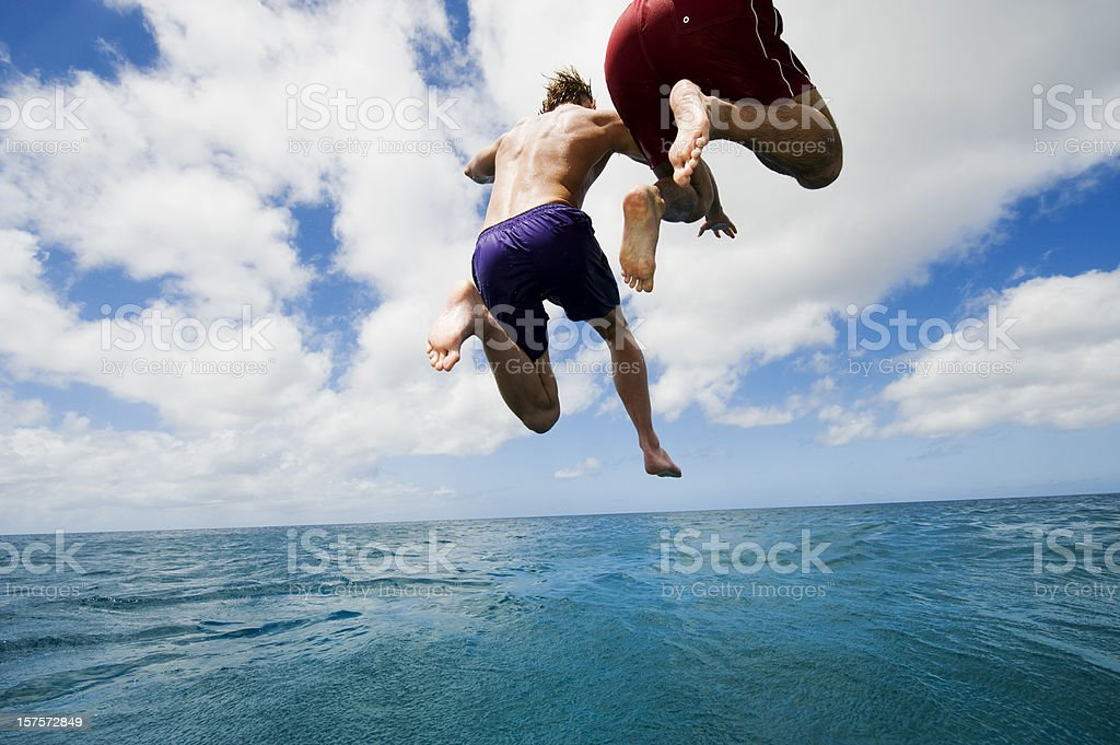 Jumping into Sea stock photo
