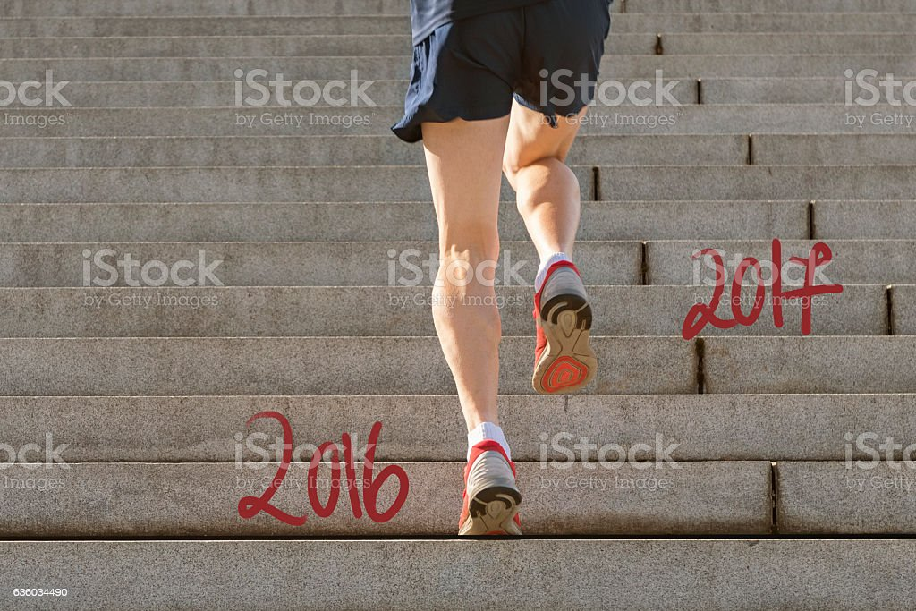 Jumping into the New Year 2017 stock photo