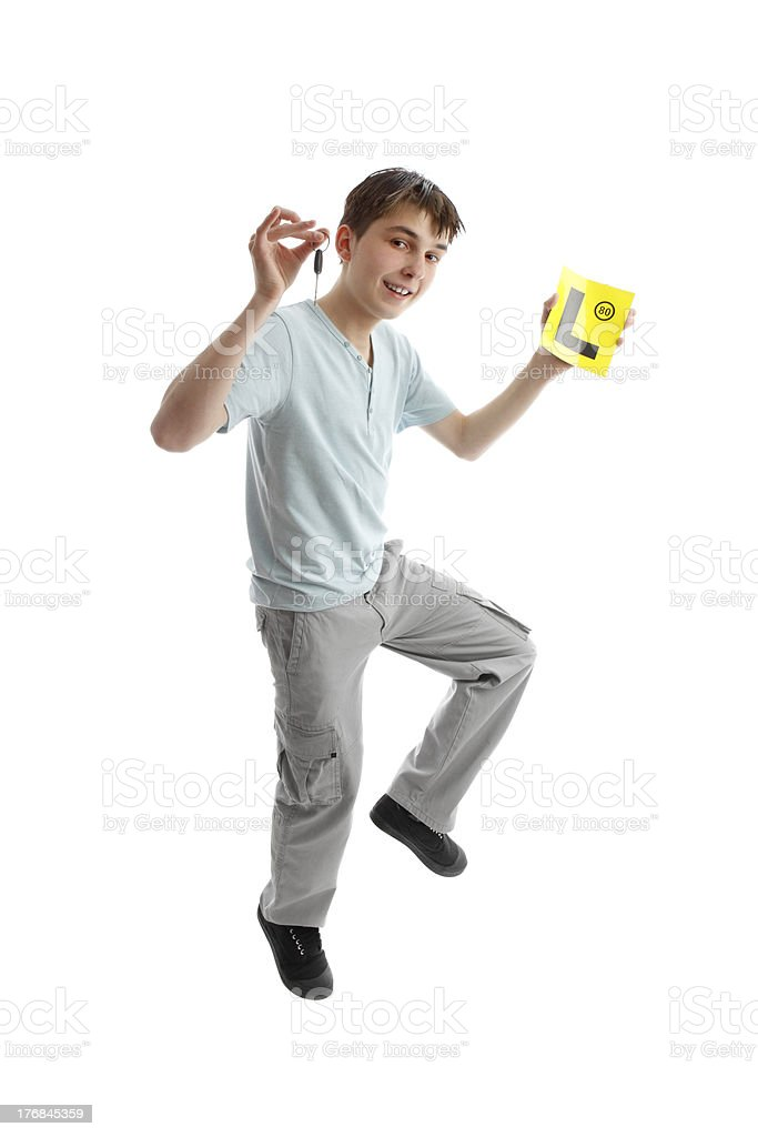 Jumping male teen Drive L Plates royalty-free stock photo