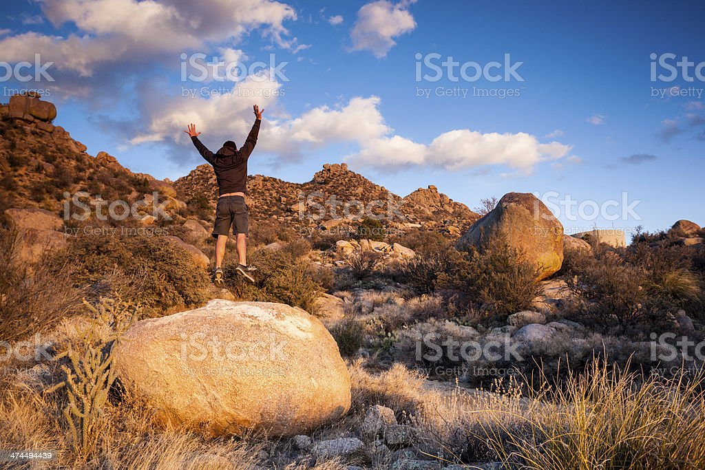 jumping man and southwest landscape sunset royalty-free stock photo