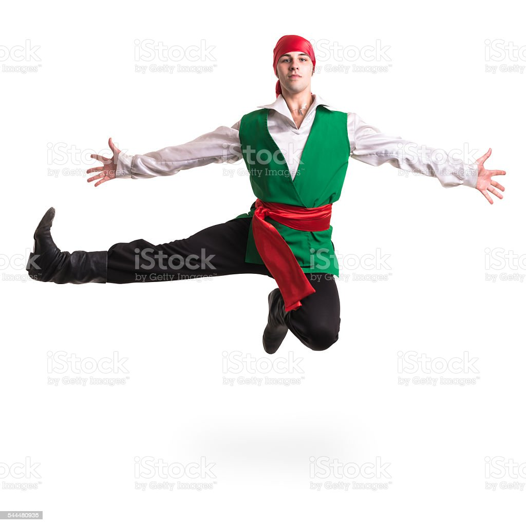 Jumping man wearing a pirate costume. Isolated on white in stock photo