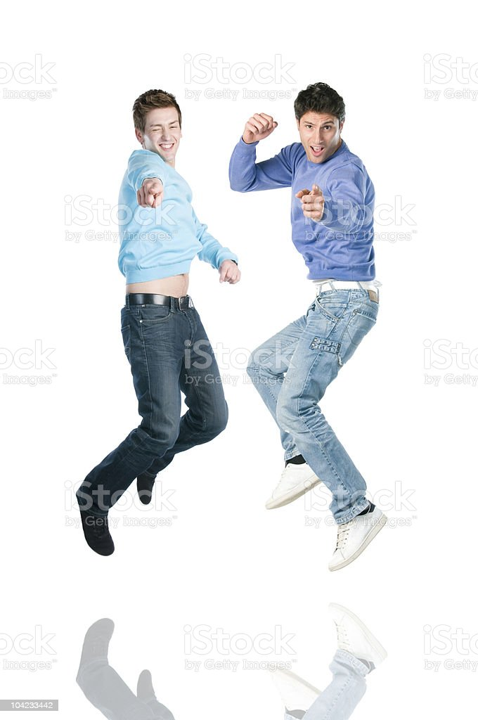 Jumping men pointing at you royalty-free stock photo