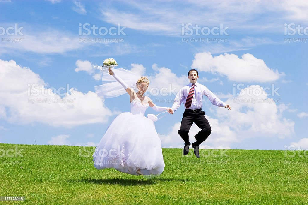 jumping newly-married couple royalty-free stock photo