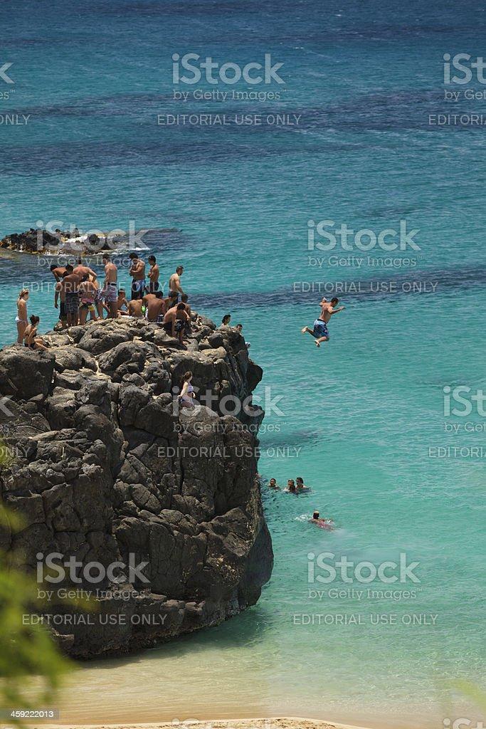 Jumping off rock on Oahu, Hawaii stock photo