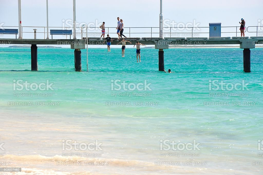 Jumping off the Jetty stock photo
