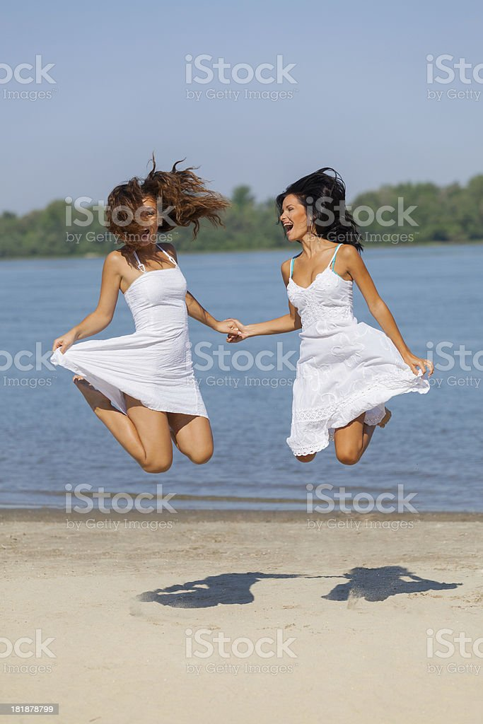 Jumping on a beach royalty-free stock photo