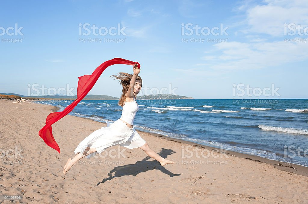 Jumping on the beach. royalty-free stock photo