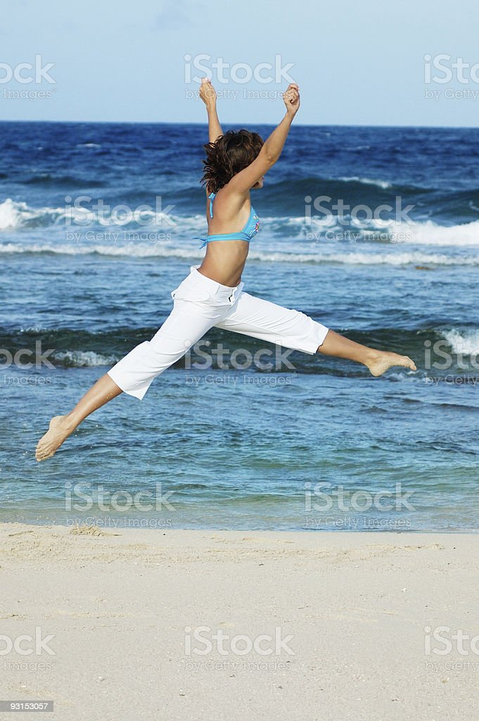 Jumping on the beach stock photo