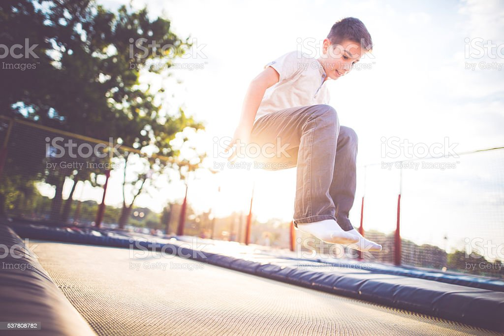 Jumping on the trampoline stock photo
