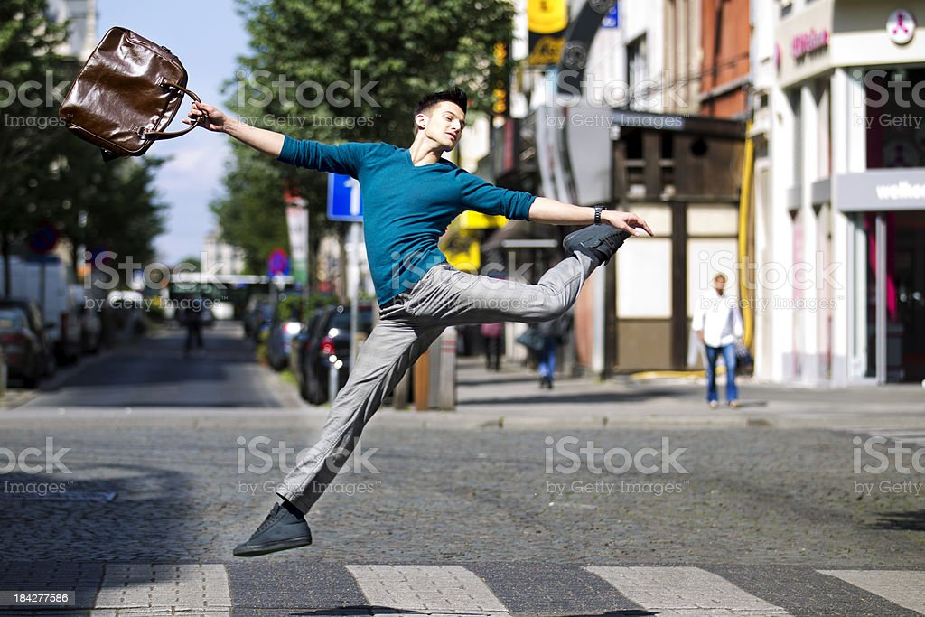 jumping over a pedestrian crossing royalty-free stock photo