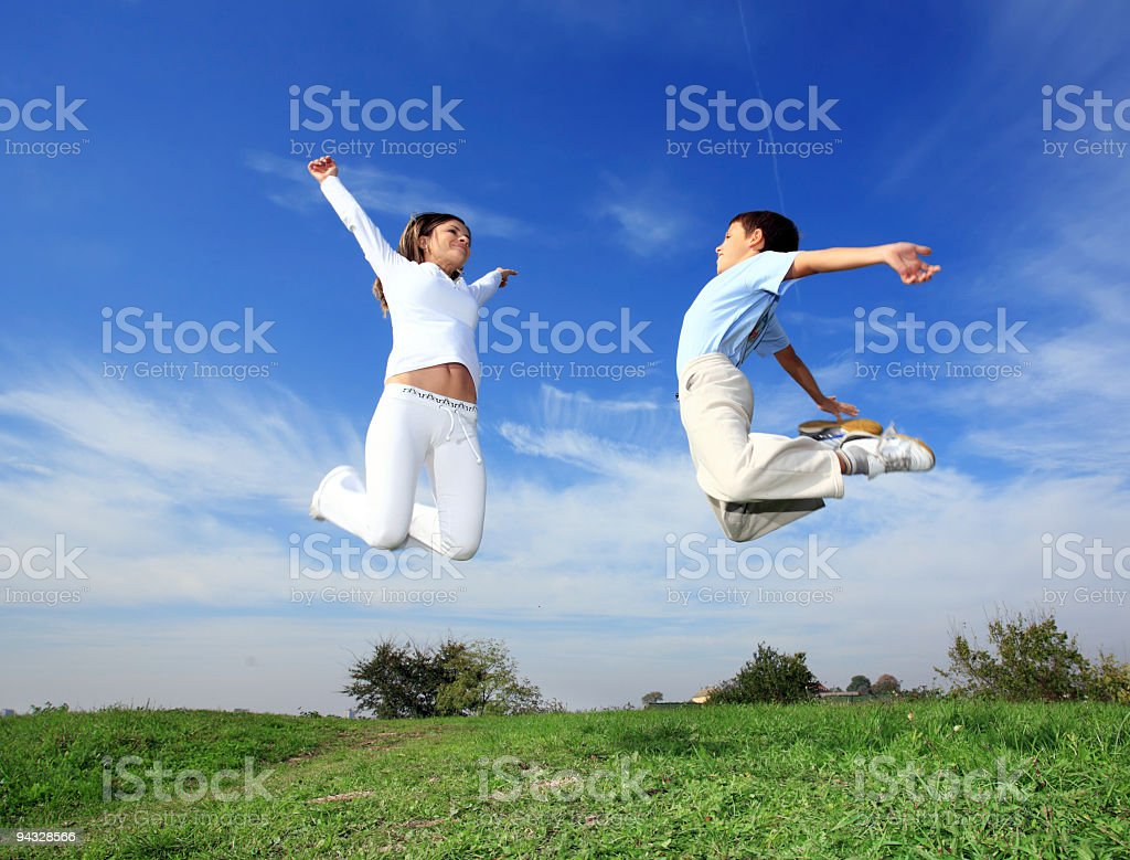 Jumping people. stock photo