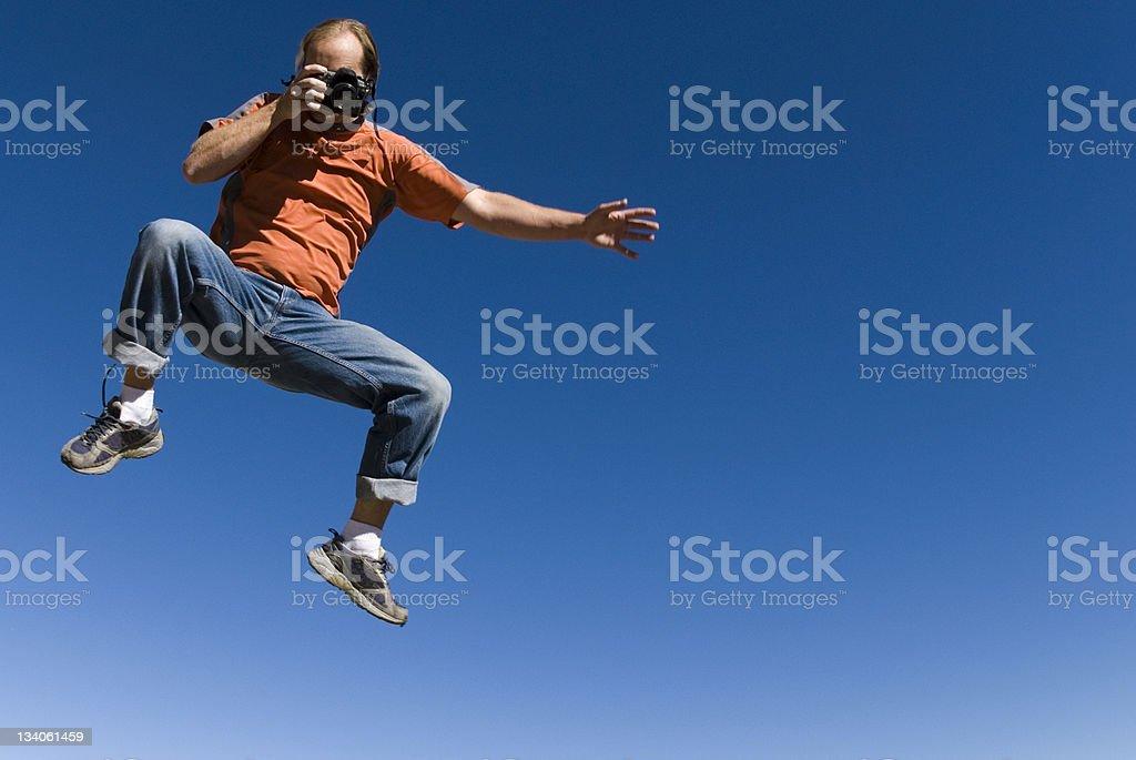 jumping photographer stock photo