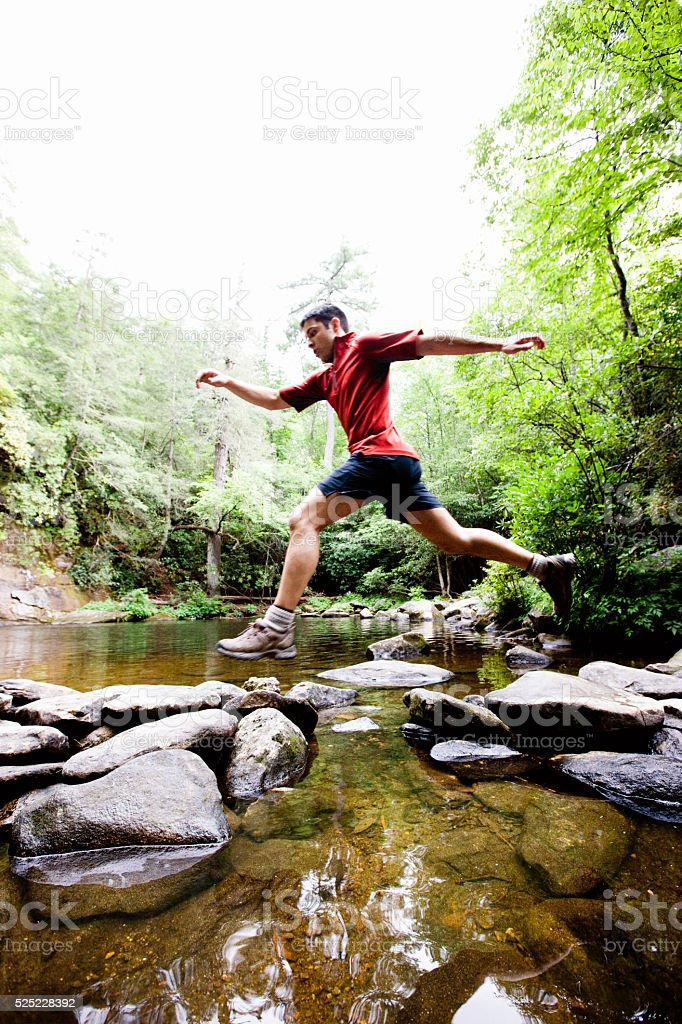 Jumping Rock to Rock stock photo