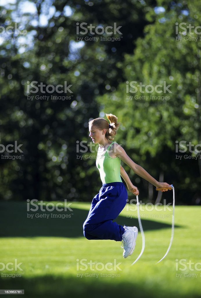 jumping rope in the park royalty-free stock photo