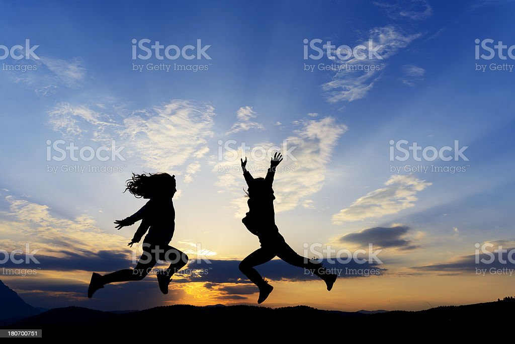 jumping silhouettes royalty-free stock photo