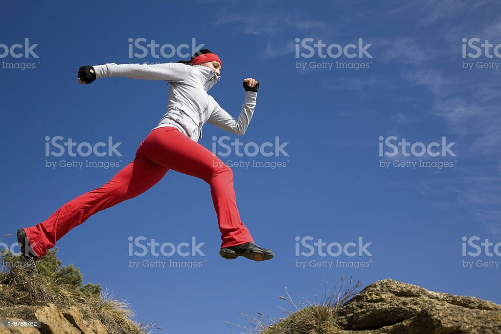 jumping sporty woman royalty-free stock photo